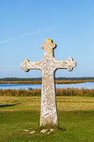 Stone cross at a beach meadow