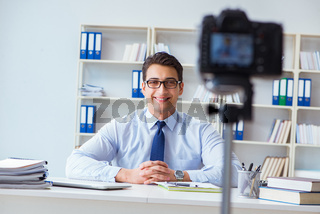 Business blogger doing webcast for his subscribers