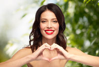beautiful woman with red lipstick and hand heart