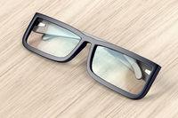 Eyeglasses on wood background