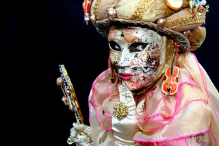 Lady with a mask covered with musical notes