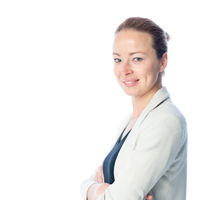 Business woman standing with arms crossed against white background.