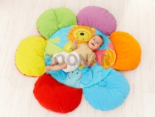 Happy baby on playmat