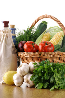 Vegetables and wicker basket on wooden table
