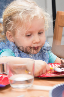 Blond girl eating dessert