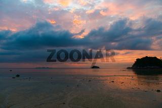 Cloudy sunrise above the sea and island