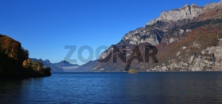 Lake Walensee and mountains of the Churfirsten range. Small island named Schnittlauchinsel.