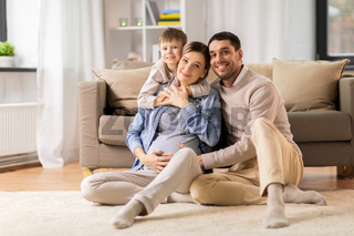 happy family with pregnant mother at home