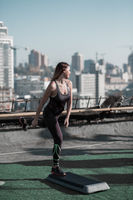 Workout with step platform on the roof of the building.