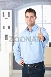 Confident man smiling thumb up