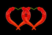 Two hearts composed of red hot chili peppers