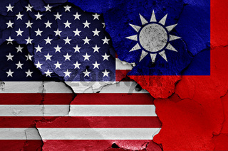 flags of USA and Taiwan painted on cracked wall