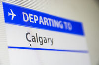Computer screen close-up of flight to Calgary, Canada