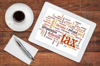 tax  word cloud  on tablet