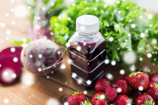 bottle with beetroot juice, fruits and vegetables