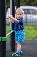 Toddler boy at playground wearing shorts and suspenders