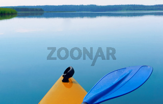 the bow of the kayak, the bow of yellow kayak over the water
