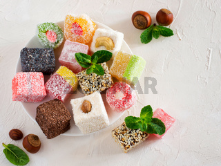 Turkish delight on white rustic background