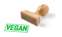 A rubber stamp on a white background - Vegan