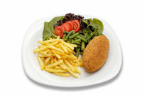 chicken cutlet with vegetables and garnish