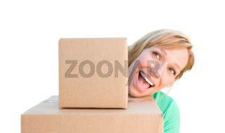 Happy Young Adult Woman Holding Moving Boxes Isolated On A White Background.