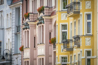 Colourful facades of old historical tenement houses