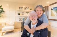 Loving Senior Couple Inside Their Home Office.