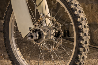 closeup of the wheel of mountain bicycle. Detail of the mountain bike. Horizontal photo. Sportive backgrounds and still-life.