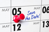 Wall calendar with a red pin - May 05