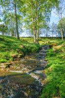 Idyllic beautiful summer landscape with a waterfall