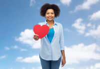 happy african american woman with red heart shape