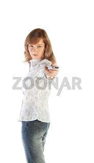 Blond woman aiming TV remote