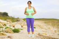 Pregnant woman doing sport in summer evening outdoors