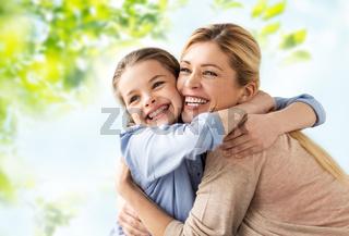 happy smiling mother hugging daughter