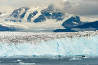 Boat Dwarfed by Mountains Glaciers Alaska Kenia Fjords
