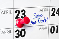 Wall calendar with a red pin - April 23