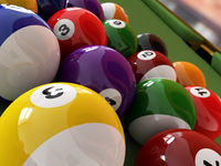 Group of billiard balls with numbers, on green pool table.
