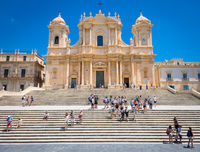 NOTO, ITALY - 21th June 2017: tourists in front of San Nicolò Cathedral, UNESCO Heritage Site