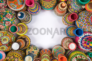 Artistic painted handcrafted pottery vases compacted around a circle