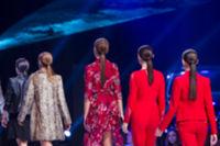 Sofia Fashion Week female models backs red suits