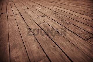 Grunge photographic background - diagonal old wooden floor boards