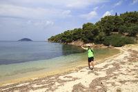 Tourists men on Aegean coast of Sithonia peninsula