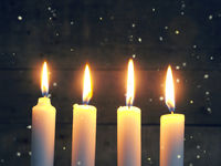 Advent candles on a wooden background