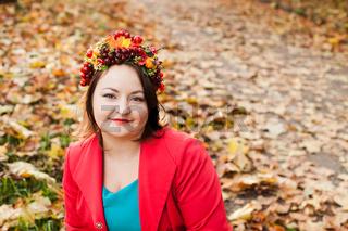Woman with autumn wreath