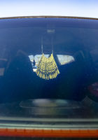 Air freshener hanging in the car on the rear view mirror