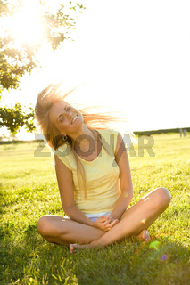 happy young woman in the summer park