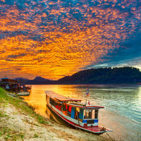 Touristic boat at sunset. Beautiful landscape. Luang Prabang. Laos.