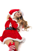 Good looking girl in Santa Claus hat with Christmas gift