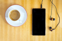 Smartphone with cup of coffee