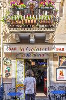 Deciding Whether To Go Into The Bar Taormina Italy